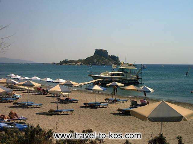 KEFALOS BEACH - The golden sand and the deep blue waters characterize the kefalos beach.