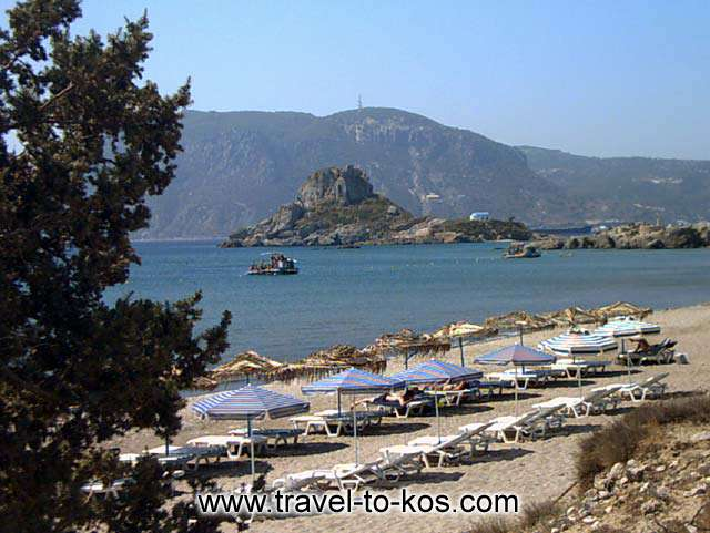 BEACH - The sandy beach of Agios Stefanos area and at the opposite side you can see the small rocky island called Kastri.
