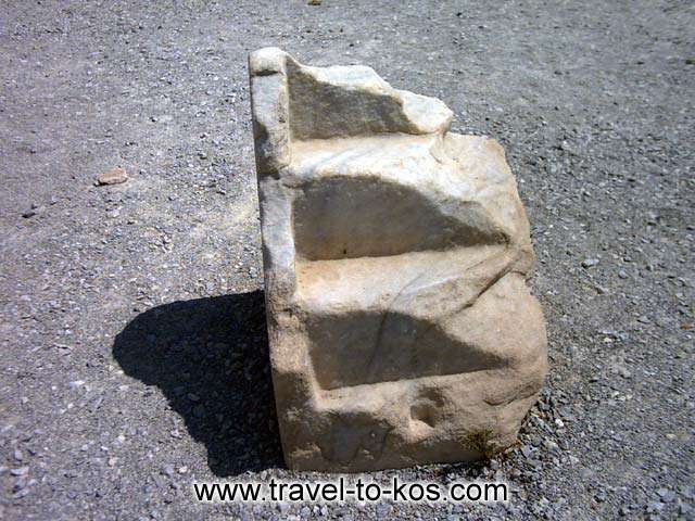 ANTIQUITIE - A piece of a marble sculpture from the Basilika of Agios Stefanos.