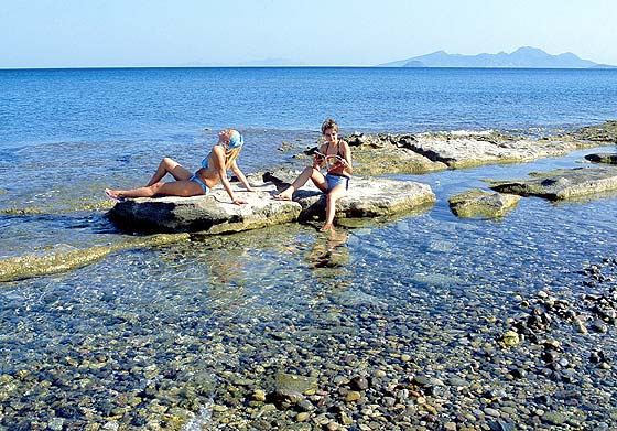 GIRLS - Two girls on a rock in Kardamena beach
