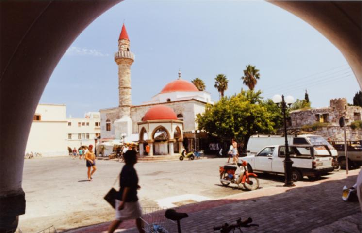 KOS TOWN - One of the liveliest and most attractive of the Greek Island capitals Kos Town is full of palm trees and flowers with many archaeological remains and imposing Venetian-style buildings...