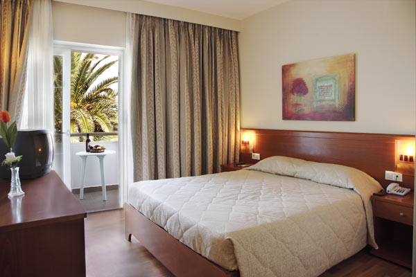 Inside view of room with two beds of Sandy Beach Hotel, located at Marmari village. CLICK TO ENLARGE